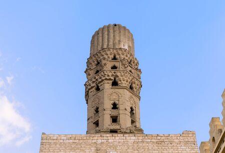 Minaret of public historic Al Hakim Mosque known as The Enlightened Mosque, located in Moez Street, Old Cairo, Egypt Banco de Imagens