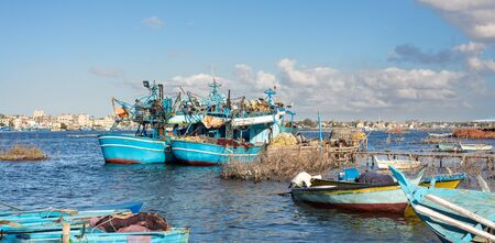Fishing boats parked at River Nile in cloudy winter day, El Borg district, Rosetta City, Egypt
