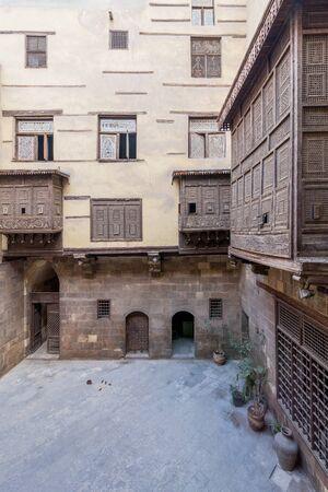 Facade of ottoman era historic house of Zeinab Khatoun with wooden oriel windows - Mashrabiya - located at Azhar district, Medieval Cairo, Egypt