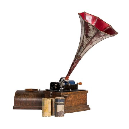 High angle cut out of 1911 old phonograph with three cylinder records, including clipping path, isolated on white