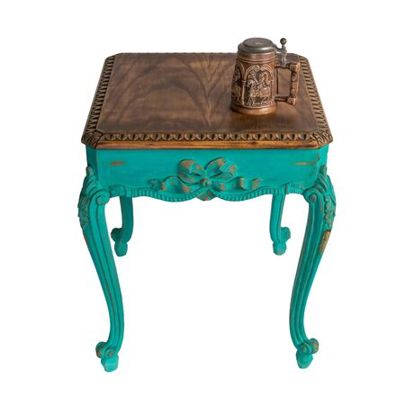 Vintage Furniture - Retro wooden vintage table with green painted legs and teapot isolated on white background including clipping path Stock Photo