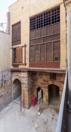 Facade of ottoman era historic Waseela Hanem House with wooden oriel windows - Mashrabiya - Medieval Cairo, Egypt