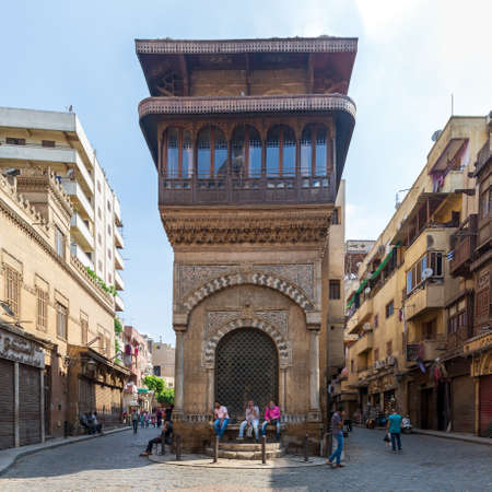 Cairo, Egypt- June 26 2020: Moez Street with few local visitors and Sabil-Kuttab of Katkhuda historic building during Covid-19 lockdown period, Gamalia district, Old Cairo Editorial