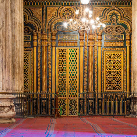 Tomb -Shrine - of Muhammad Ali Pasha with floral and geometric pattern golden decorations, at the great Mosque of Muhammad Ali - Alabaster Mosque - situated in the Citadel of Cairo in Egypt