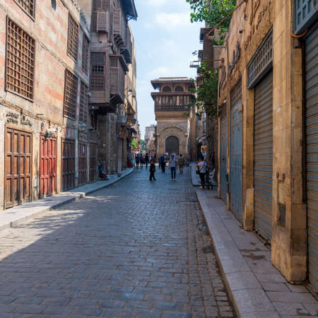 Cairo, Egypt- June 26 2020: Moez Street with few local visitors and Sabil-Kuttab of Katkhuda Mamluk era historic building at the far endduring Covid-19 lockdown period, Gamalia district, Old Cairo Editorial
