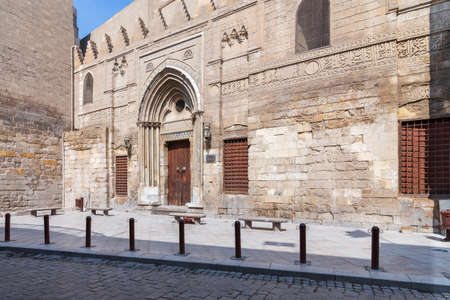 Facade of theological school and Mausoleum of Sultan Qalawun, Mamluk era historic building, at Moez Street, Gamalia district with no visitors during Covid-19 lockdown period, Old Cairo, Egypt Stock Photo