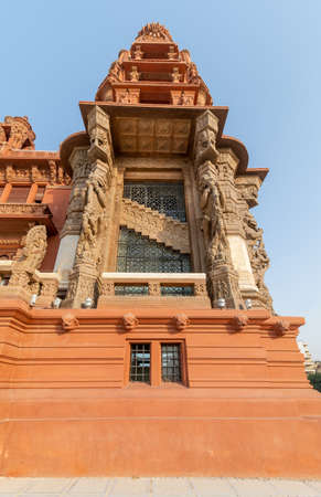 Low angle of the tower of Baron Empain Palace, a historic mansion inspired by the Cambodian Hindu temple of Angkor Wat, located in Heliopolis district, Cairo, Egypt Stock Photo