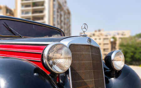 Cairo, Egypt- July 29 2020: 1953 Black and red Mercedes antique car, displayed in front of Baron Empain Palace, located in Heliopolis District