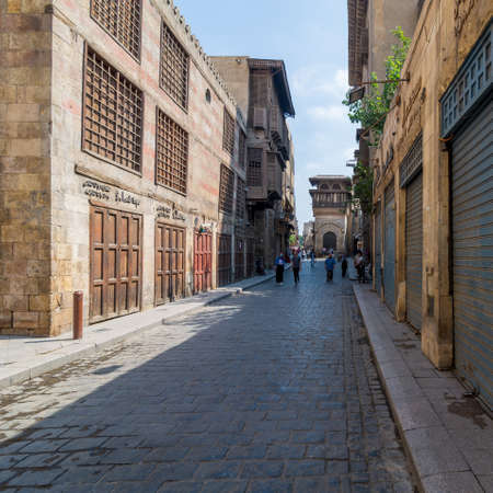 Cairo, Egypt- June 26 2020: Moez Street with few local visitors and Sabil-Kuttab of Katkhuda Mamluk era historic building at the far end during lockdown period, Gamalia district, Old Cairo Editorial