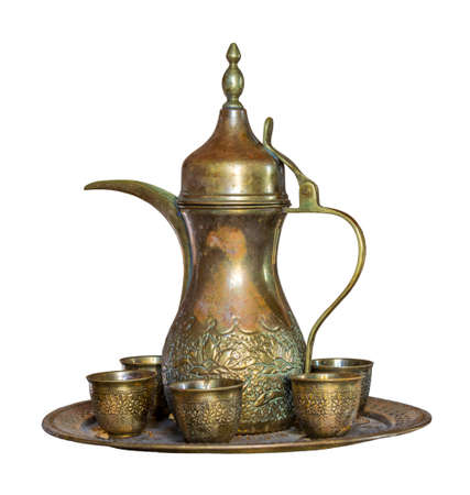 Turkish coffee set: Ottoman ornate coffee pot and small ornate cups, isolated on white with clipping path