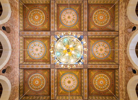 Wooden ceiling decorated with colorful floral patterns and dome at Mamluk era Imam Al Shafii Mosque situated Old Cairo, Egypt