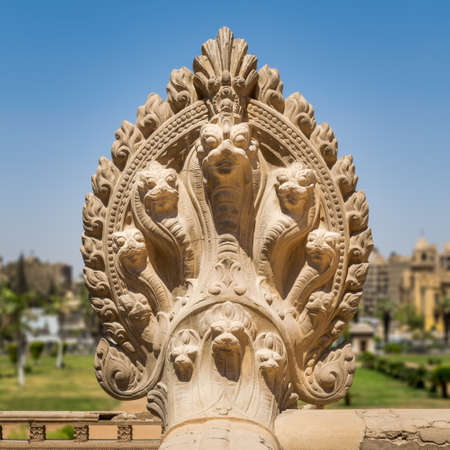 Hindu statue of snakes. One of the statues studding the terrace of the historical palace of Baron Empain before restoration, Cairo, Egypt Stock Photo