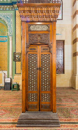 Old aged wooden door of Minbar of Imam Al Shafii Mosque with arabesque decorations tongue and groove assembled, inlaid with ivory and ebony, Old Cairo, Egypt Stock Photo