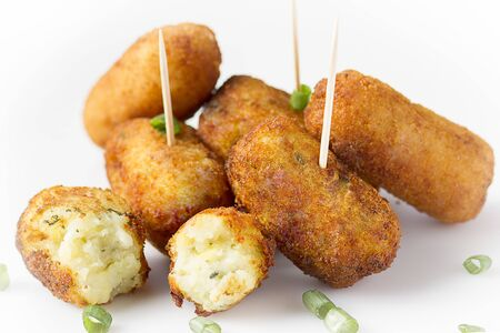 home made croquettes on white table