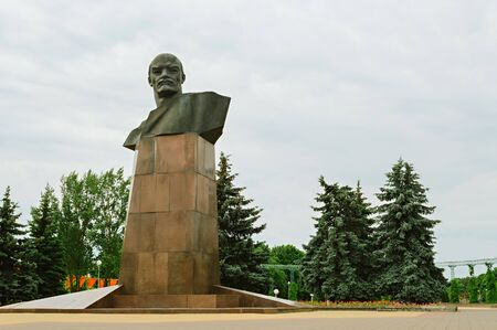 Monument to Vladimir Ilyich Lenin on a background of cloudy sky in the park of the city of Soligorsk, Belarus. The traditional architecture of the Soviet Union, a symbol of the era of socialism Stock Photo