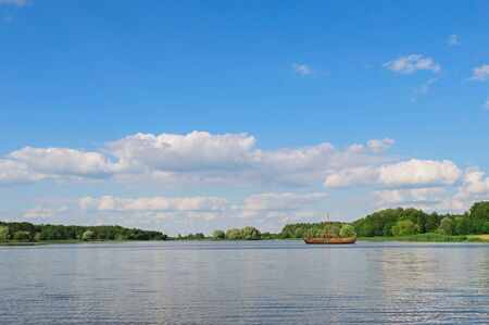 Panoramic view with beautiful blue sky and clouds on the lake near Nesvizh castle. Postcard concept. Background image with copy space