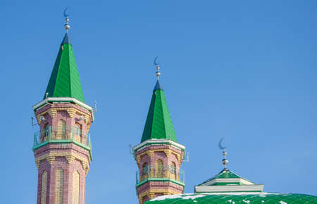 minarets: Minarets of mosque with Crescent on blue sky background