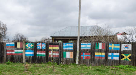 nat: The flags painted on the old fence