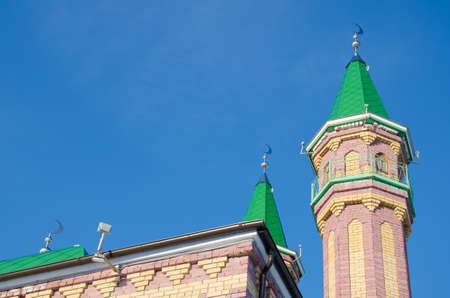 minarets: Minarets of mosque with rescent on blue sky background