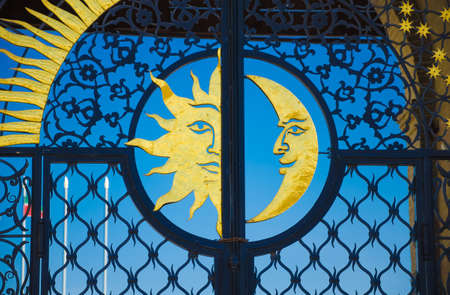 moon gate: The metal gate of the tower Syuyumbike with a golden sun and moon. Historic and Architectural Complex of the Kazan Kremlin.  Kazan, Republic of Tatarstan, Russia.