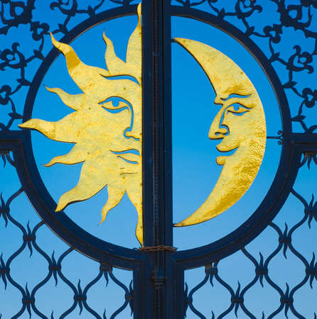 moon gate: The metal gate of the tower Syuyumbike with a golden sun and moon. Historic and Architectural Complex of the Kazan Kremlin. UNESCO World Heritage Site. Kazan, Republic of Tatarstan, Russia.