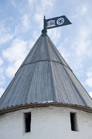 architectural heritage of the world: Russia, Republic of Tatarstan, city of Kazan. Historic and Architectural Complex of the Kazan Kremlin. UNESCO World Heritage Site. A cone-shaped roof of the South-West tower with a metal flag with the symbol of UNESCO. Editorial