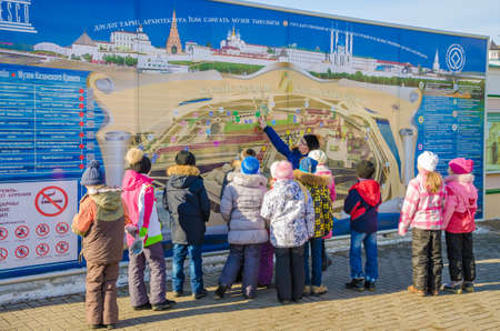 architectural heritage of the world: Kazan, Republic of Tatarstan, Russia - February 20, 2016: Historic and Architectural Complex of the Kazan Kremlin. UNESCO World Heritage Site. Stand with the plan of the Kazan Kremlin. School excursion. The teacher-guide shows to school students an arrang