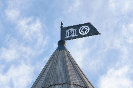 architectural heritage of the world: Russia, Republic of Tatarstan, city of Kazan. Historic and Architectural Complex of the Kazan Kremlin. UNESCO World Heritage Site. Metal flag with symbols of UNESCO on the roof of the South-Eastern tower. Editorial