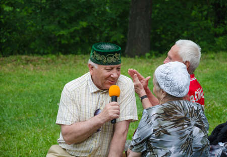 field work: Kazan, Republic of Tatarstan, Russia - May 28, 2016: Singer Almaz Khamzin sings a song. Sabantuy (translated from Tatar - feast of the plow) is a traditional celebration of the end of spring field work. Khamzin Almaz - honoured art worker of the Republic