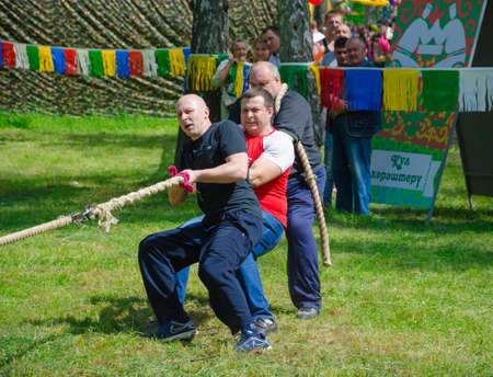 field work: Kazan, Republic of Tatarstan, Russia - May 28, 2016: Competitions in tug of war among men. Sabantuy (translated from Tatar - feast of the plow) is a traditional celebration of the end of spring field work.