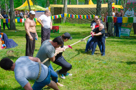 Kazan, Republic of Tatarstan, Russia - May 28, 2016: Competitions in tug of war among men. Sabantuy (translated from Tatar - feast of the plow) is a traditional celebration of the end of spring field work.