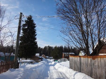 path cottage garden: Village in the winter Stock Photo