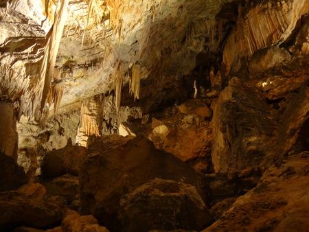 stalagmites: Stalactites and stalagmites are in a big cave