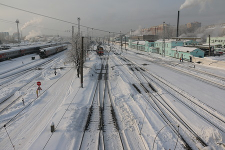 clop: Railway and white snow in winter day Stock Photo