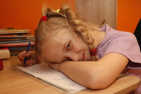 tired person: Schoolgirl learns lessons