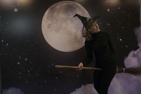 actresses: Witch, moon and clouds at night on Halloween Stock Photo