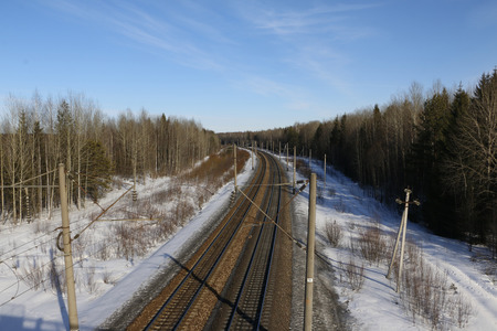 clop: Railway in sunny spring day and forest around Stock Photo
