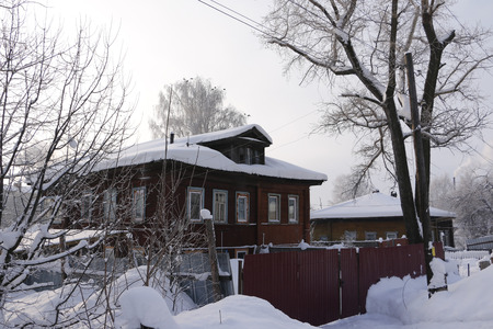 log cabin winter: Village in a winter day and snow