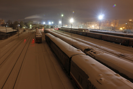 clop: Railway in winter night and white snow