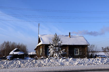 ownerships: House in a village in a winter day