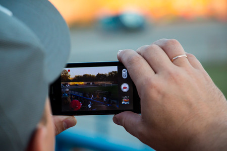 Russia, Kirov - August, 09, 2016: Spectators are taking pictures of extreme auto show in Kirov city in 2016 Editorial