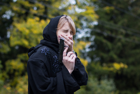 saboteur: Muslim woman with arms in autumn day