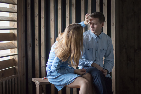 Beautiful couple in a room lined with wood