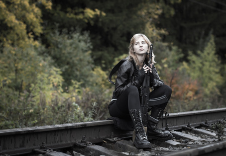 saboteur: Girl with arms on the rails in autumn day