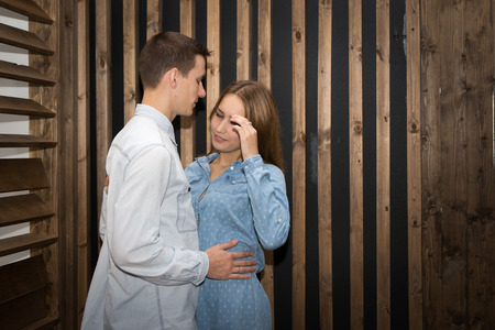 handsom: Beautiful couple in a room lined with wood