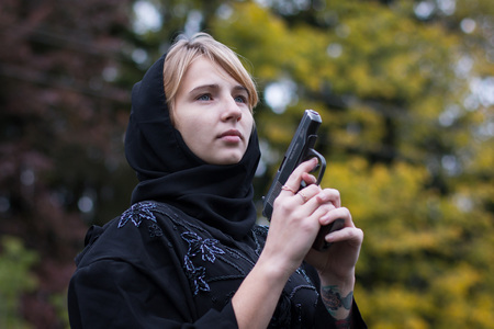 saboteur: Woman in muslim dress with arms