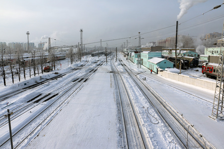 sleepers: Railway in a winter day and snow around