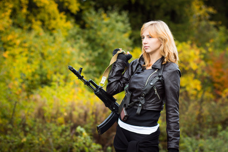 saboteur: Nice girl with arms in autumn day