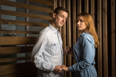 loving couples: Beautiful couple in a room lined with wood