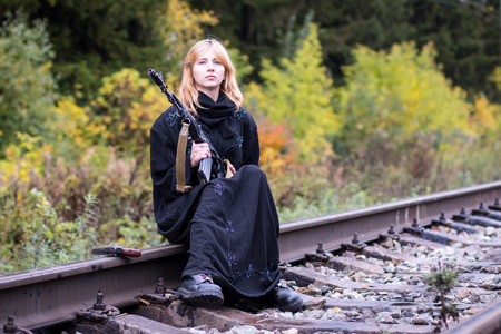 saboteur: Muslim woman with arms on the rails